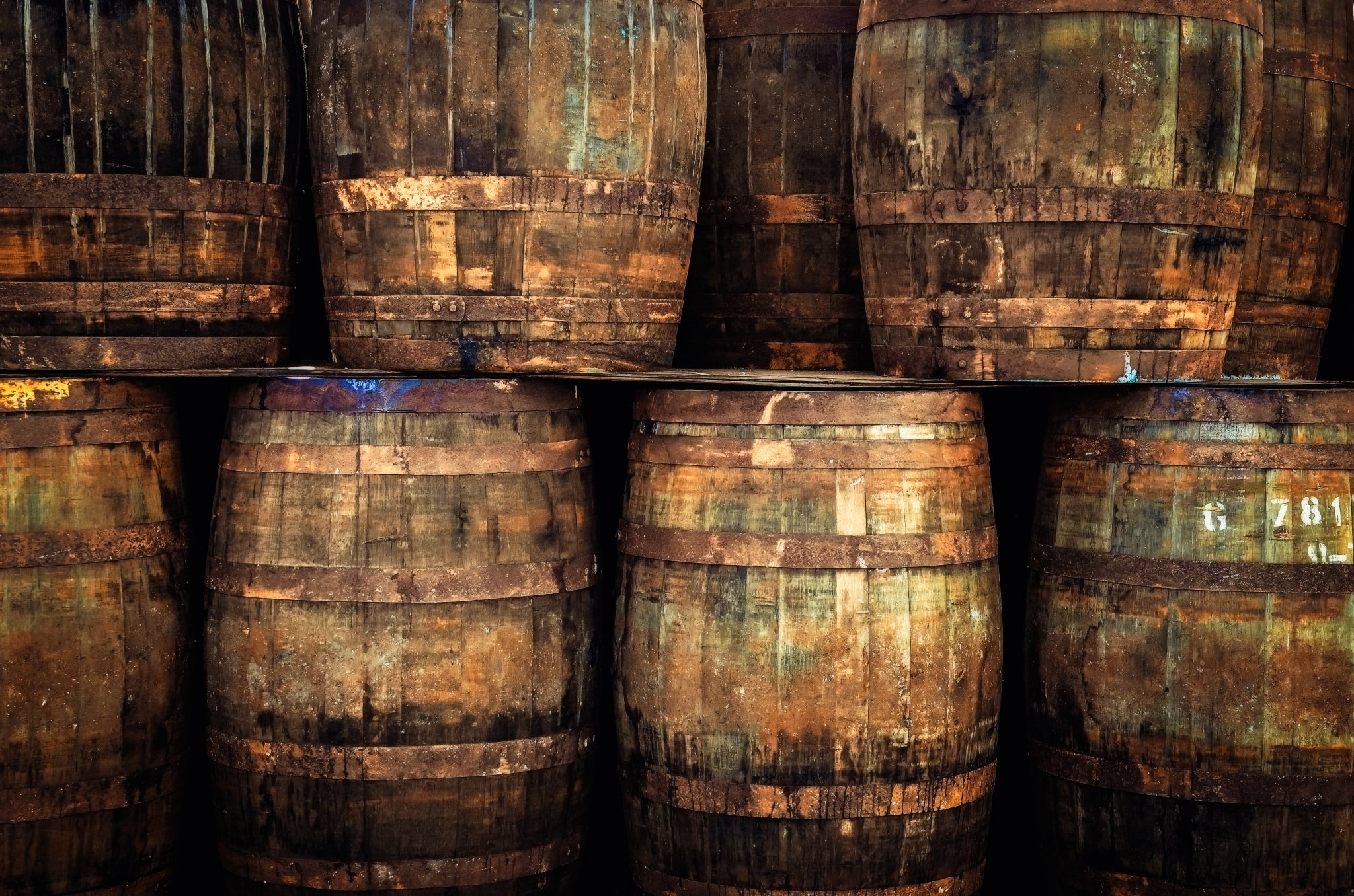 Stacked pile of old wooden whisky barrels