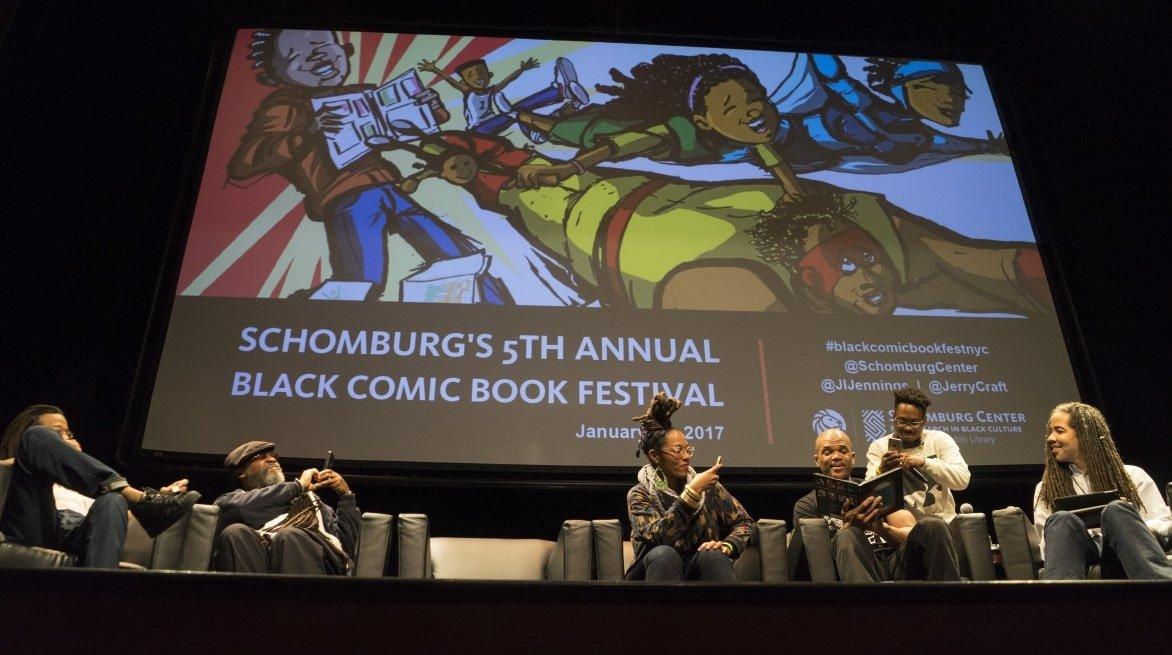 Black-Comic-Con-2017-DMC-of-Run-DMC-reads-his-comic-book.jpg