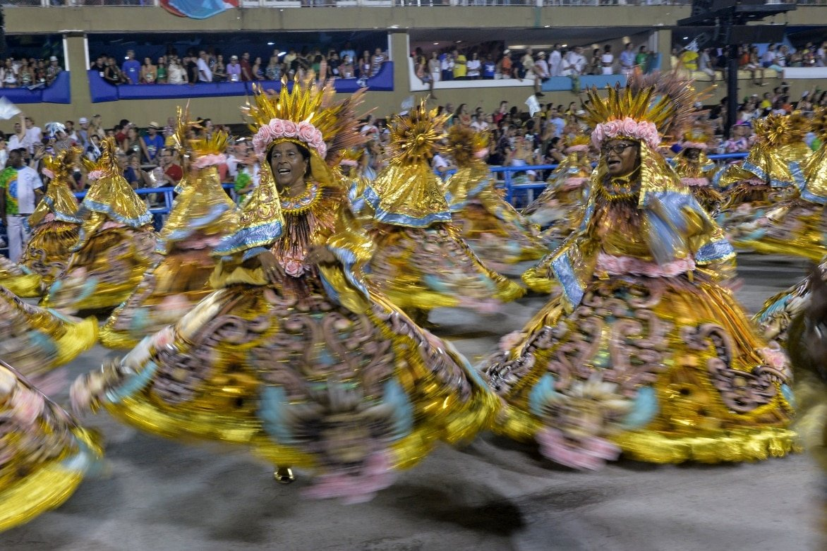 Carnival-Rio-Brazil-february-12-2018-Samba-School-Beija-Flor-perform-at-Marques-de-Sapucai-known-as-Sambodromo-for-the-Carnival-Samba-Parade-competition.-Baiana-in-motion-Blur.jpg
