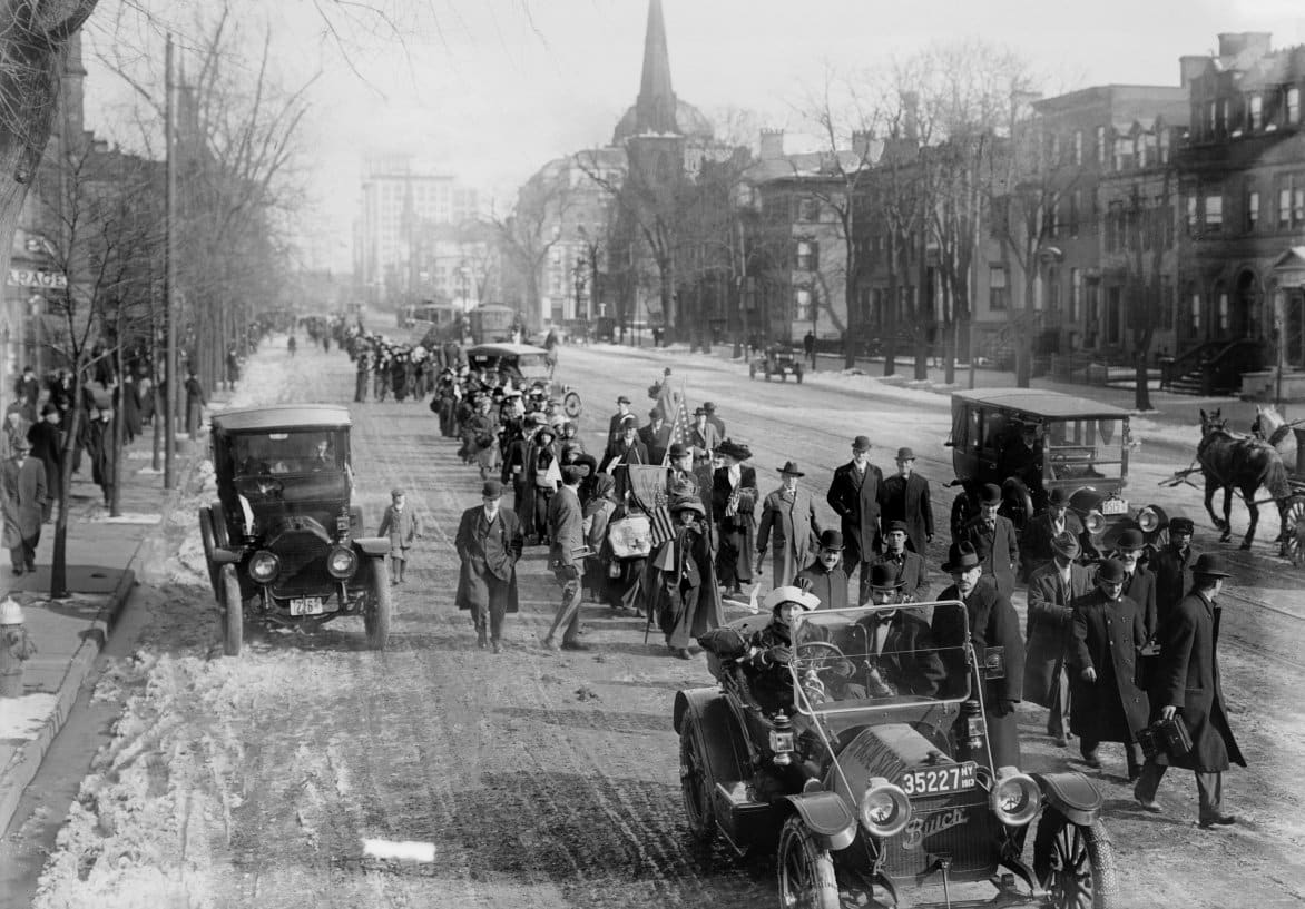 Newark-Suffrage-hikers-on-way-to-Washington-walking-through-Newark-New-Jersey-on-Broad-Street-February-12-1913.-The-hike-was-organized-and-led-by-General-Rosalie-Jones-leading-behind-the-first-car.jpg